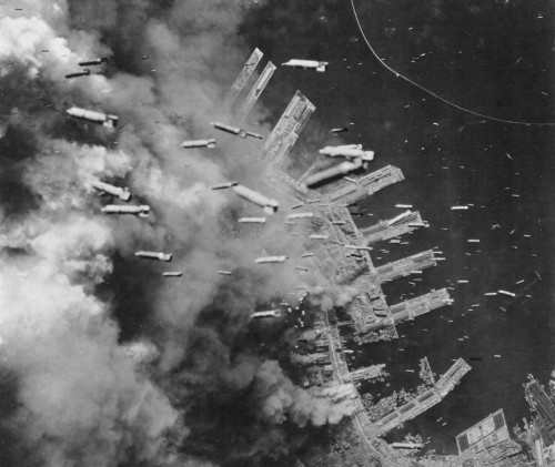 Incendiary bombs are dropped by U.S. Army Air Forces on Kobe, Japan, 4 June, 1945.